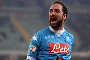 Gonzalo Higuain celebrating a goal during the Italian Serie A football match between AC Chievo Verona and SSC Napoli.