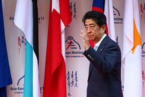 Japanese Prime Minister Shinzo Abe arrives for the 11th Asia-Europe Meeting (ASEM) Summit of Heads of State and Government (ASEM11) in Ulan Bator, Mongolia on July 15.