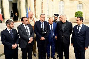 French Jewish, Buddhist, Christian and Muslim leaders speaking to the media after meeting the French President, in Paris, on July 27, 2016.