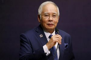 Malaysia's Prime Minister Najib Razak speaks at the opening of a conference in Kuala Lumpur.
