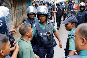 Police keep residents away near the site of a police operation on militants on the outskirts of Dhaka.