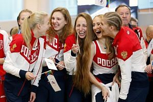 Russia's synchronised swimming Olympic team members in high spirits during a farewell ceremony before departing for the Rio Olympics at Sheremetyevo International Airport.