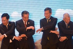 (From left) Vietnam's Foreign Minister Pham Binh Minh, China's Foreign Minister Wang Yi, Singapore's Foreign Minister Vivian Balakrishnan and the Philippines' Foreign Secretary Perfecto Yasay getting ready for a group photo during the Asean-China mee