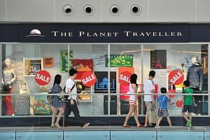 The Planet Traveller storefront, which has the Sale sign on it, on May 28.