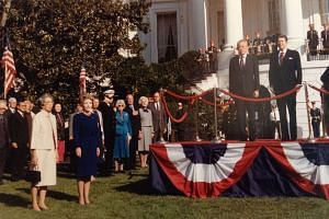 Then PM Lee Kuan Yew with then President Reagan at the ceremonial welcome on the White House lawn before the state dinner on Oct 8, 1985. With them are Mrs Lee, Mrs Reagan, then Secretary of State George Shultz (third from right on the lawn) and then Vice