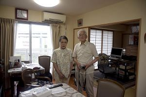 Dr Jun Sasaki (at right) said research has shown the benefits of single rooms compared with shared ones. With him is Dr Kenichi Sato, a consultant and instructor at the Japan Primary Care Association. Mrs Yoshiko Takahashi, 81, and her husband Akio T