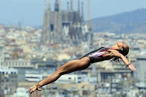This is one of the enduring images in diving with Barcelona's Sagrada Familia basilica being the backdrop. Pandelela Rinong is seen taking off during the 10m platform semi-finals at the 2013 Fina World Championships, where she won a bronze in the 10m