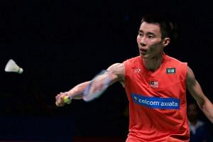 Lee Chong Wei of Malaysia hits a return against Ihsan Maulana Mustofa of Indonesia during their men's singles semi-final match at the Indonesia Open badminton tournament on June 4.