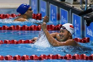 Nguyen Thi Anh Vien (white cap) after winning one of her swimming events at the 28th SEA Games in June 2015.