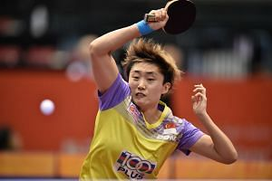 Feng Tianwei of Singapore hits a return against Taiwan's Cheng I-Ching during their women's singles quarter-final table tennis match at the ITTF World Tour Japan Open table tennis tournament on June 18.