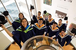 Graduating from NTU this year are (front row, from left) Ms Wong Jyun Yir, Mr Alphonsus Seng, Mr Liu Zongsheng, Mr Loh Yun Xuan and their respective twins (back row, from left) Ms Wong Jyun Yao, Mr Alphonso Seng, Mr Liu Zongli and Mr Loh Yun Xian.