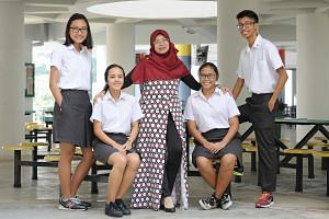 Madam Zainun Hashim, coordinator for the Malay Language Elective Programme, with four Pioneer Junior College students in the programme. They are (from left) Hanisah Syahirah Mohd Yani, 18; Nur Salina Rahmat, 19; Siti Rezkiah Mohd Radzelee, 17, and Mi