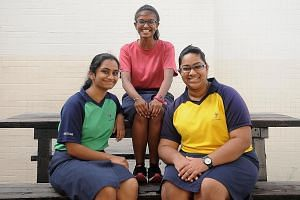 JC2 students (from left) C.H. Sanjana, Sangeetha Muthukumar and Deenah Haja Maidin are reading both local and Indian texts as part of their Tamil Language and Literature classes at Yishun Junior College.