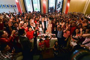 PM Lee and Mrs Lee pose for a group photo with fellow Singaporeans at the National Day celebrations at the Singapore embassy in Washington, DC, on July 31.