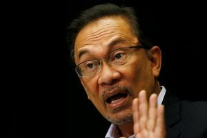 Malaysia's opposition leader Anwar Ibrahim speaks to the media in Kuala Lumpur on Feb 4, 2015.