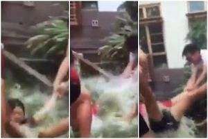 Screengrabs of a video shared last week showing an alleged dunking during orientation activities at Sheares Hall in NUS.