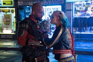 Will Smith as Deadshot and Margot Robbie as Harley Quinn (both above) in Suicide Squad, and Tatsuya Fujiwara (left) as an aspiring manga creator in Erased.