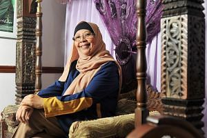 """Madam Salamah, 55, a mosque manager and mother of four children, suffers from chronic conditions but plans to still be working when she is 65 if her health permits. """"I would rather keep my CPF money in reserve first and get more later, in case I need"""