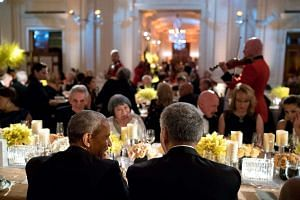 United States President Barack Obama (left) turning to Prime Minister Lee Hsien Loong at the state dinner.
