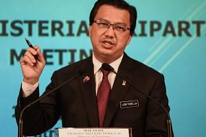 Malaysia's Transport Minister Liow Tiong Lai speaks during a joint press conference of the Ministerial Tripartite Meeting on the search for missing Malaysia Airlines flight MH370 at the Malaysian federal administrative centre in Putrajaya on June 22.