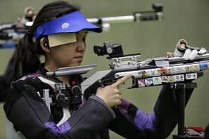Shooter Jasmine Ser of Singapore focusing before an attempt during the Rio2016 Olympic Games women's 10m air rifle event on Aug 6, 2016.