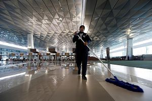A worker cleaning the new Terminal 3 at Soekarno-Hatta International Airport in Jakarta. It will open on Tuesday after nearly two months of delays due to blind spots at some of its aprons and power supply issues.
