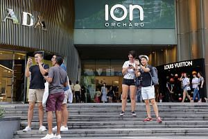 Pokemon Go fans looking for the iconic virtual monsters outside Ion Orchard, after the shopping mall started releasing lures. These are items that players can buy in-game which attract more Pokemon to the area. The mall is taking advantage of the gam