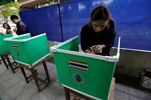 Thai electoral workers set up a polling station ahead of a constitutional referendum vote in Bangkok, Thailand on August 7.