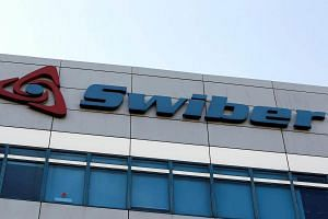 A Swiber logo is pictured at their office in Singapore on July 10, 2013.