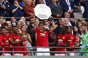Manchester United's Zlatan Ibrahimovic celebrates with the trophy after winning the FA Community Shield.