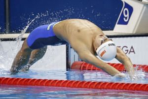Quah Zheng Wen in action in the men's 100m backstroke heats at the Olympic Aquatics Stadium in Rio de Janeiro on Sunday.