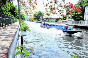 Clockwise from far left: A commuter boat plying the picturesque Saen Saeb canal which runs through the heart of central Bangkok; the currently free service is packed during the morning rush hour and carries some 60,000 people daily; Ms Mongkol Kongsr