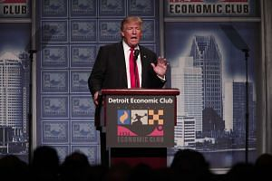 Republican presidential candidate Donald Trump delivers his economic policy address at the Detroit Economic Club on Monday.