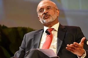 DBS Group Holdings chief executive Piyush Gupta attending a conference session at DBS Asia Leadership Dialogue in Singapore on Aug 4, 2016.