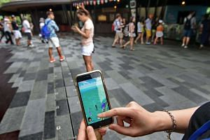 User plays Pokemon Go outside the Singapore zoo on August 7.