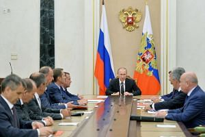 Russian President Vladimir Putin attends a meeting with permanent members of the Security Council at the Kremlin in Moscow, on Aug 11, 2016.