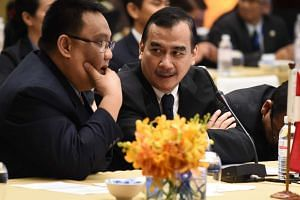 Indonesian Senior Advisor to the Minister on Energy Arief Yuwono (right) takes part in a meeting of environment ministers from Asean in Kuala Lumpur, on Aug 11, 2016.
