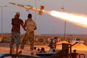 Pro-government fighters fire a rocket at ISIS militants in Sirte, Libya, Aug 4, 2016.
