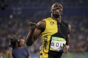 Usain Bolt of Jamaica is victorious in the 100m men's final with a time of 9.81s.