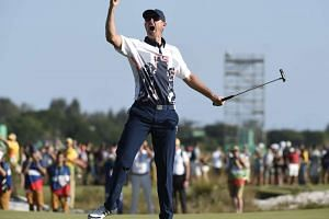 Justin Rose of Great Britain reacts after sinking his final putt to win the gold medal AT the Rio 2016 Olympic Games on Sunday (Aug 14).