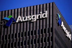 The logo for Australia's biggest electricity network Ausgrid adorns the headquarters building in central Sydney, Australia on July 25.
