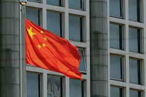 The Chinese national flag is seen on a flagpole in Beijing on August 8.