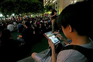 Pokemon Go players in Hougang Avenue 10, where scores of people have been seen jaywalking or running across the road while playing the mobile game. The two men arrested for affray yesterday face a prison sentence of up to one year or a fine of $5,000
