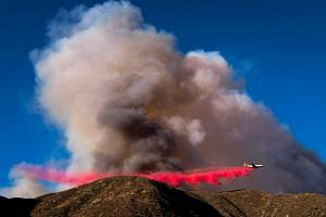 An air tanker drops fire retardant on the Blue Cut wildfire in Lytle Creek, California on August 16.