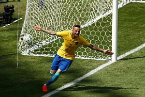 Brazil's Luan celebrates after scoring against Honduras.