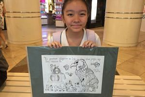 Twelve-year-old Jolie Lim with the A3-sized drawing she made for Joseph Schooling.