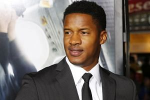 Actor Nate Parker poses at the premiere of his new film Non-Stop in Los Angeles, California on Feb 24, 2014.