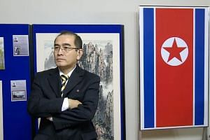 The North Korean Embassy in west London, where Mr Thae was second in rank to ambassador Hyon Hak Bong. It is not known how Mr Thae eluded embassy staff, who are required to monitor one another to thwart treason. Mr Thae Yong Ho at an exhibition of No