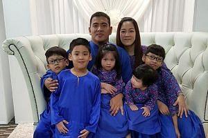 Mr Mirza with his wife Eileen and their children (from left) Ermann, Ezatt, Nur Ezelle, Nur Ezabelle and Nur Ezanne.