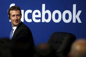 Mark Zuckerberg is seen on stage during a town hall at Facebook's headquarters in Menlo Park, California September 27, 2015.